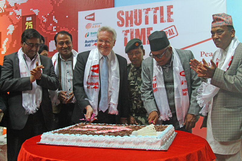 Minister for Youth and Sports Satya Narayan Mandal (second from right) and Australian nAmbassador to Nepal Glenn White cutting the cake as other officials look on during the launching ceremony of Shuttle Time Nepal in Kathmandu on Monday. Photo: THT