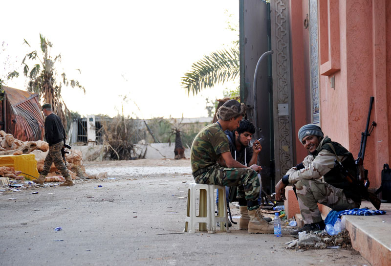 FILE - Fighters battling the Islamic State Group take a break from fighting in the Hawari area, southwest of the city of Benghazi, Libya, on Thursday, March 10, 2016. Photo: AP