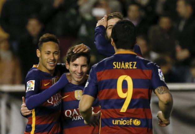 Barcelona's Lionel Messi celebrates with team mates Luis Suarez and Neymar after scoring his second goal. REUTERS/Sergio Perez