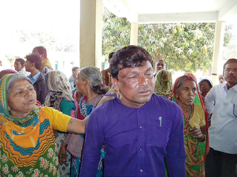 A local woman holds Shekh Chand Ali, Assistant Technician of Jatahara Village Development Committee, alleging him of irregularity in the social allowance distribution, in Gaur of Rautahat district. Photo: Prabhat Kumar Jha
