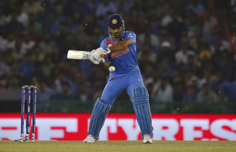 India's captain Mahendra Singh Dhoni plays a shot during ICC World Twenty20 Cricket Tournament against Australia in Mohali on Sunday, March 27, 2016. Photo: Reuters