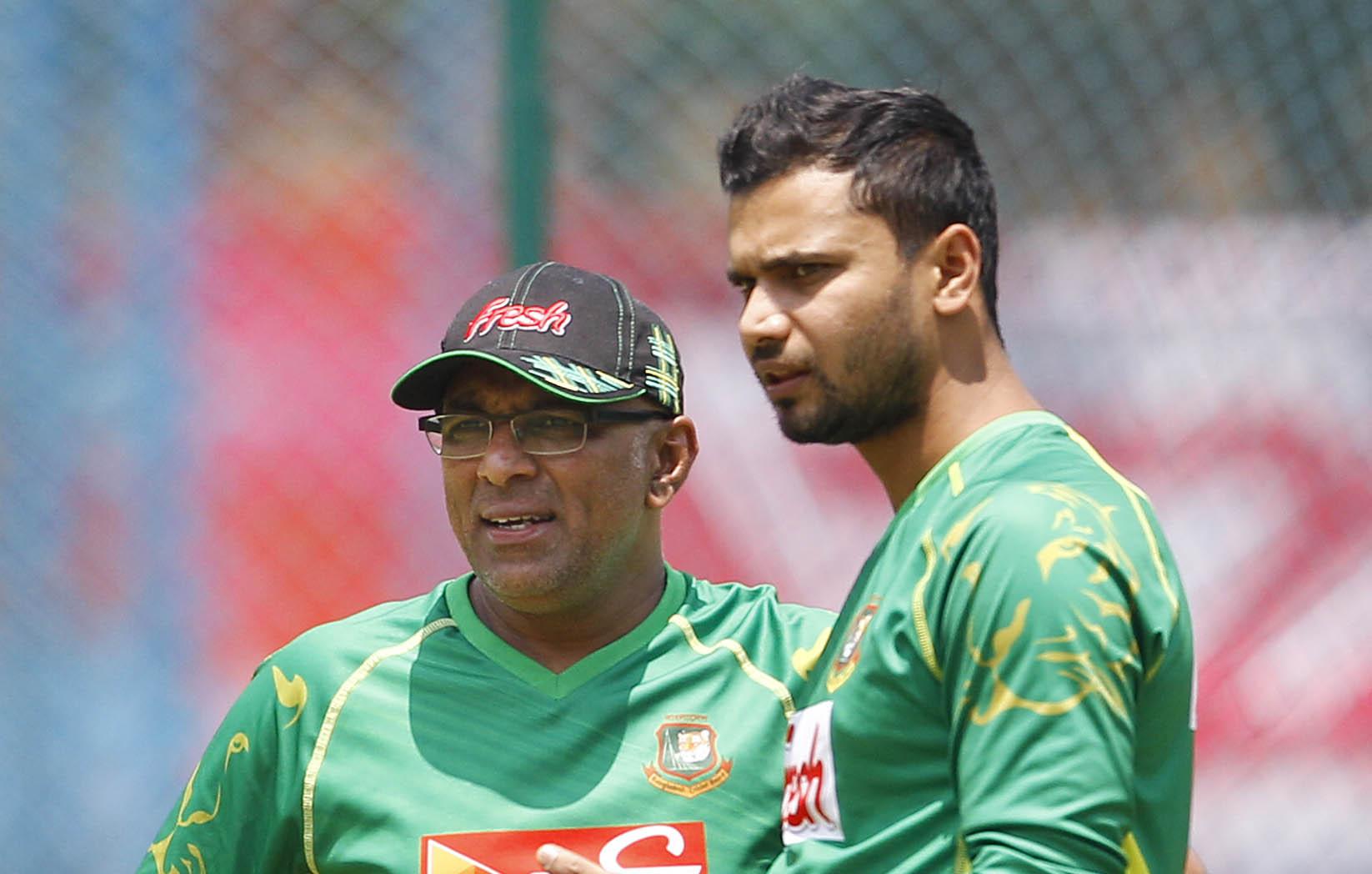 Bangladesh captain Mashrafe Mortaza  (right) talks with coach Chandika Hathurusingha in Bangalore on Sunday, on the eve of their match against Australia.