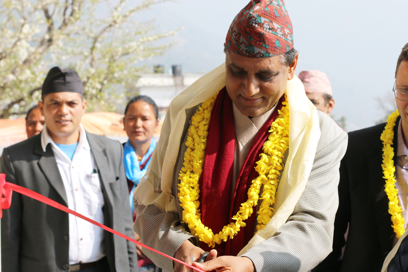 Minister for Culture, Tourism and Civil Aviation Ananda Prasad Pokharel inaugurates a health clinic in Dolakha district, built as a part of post-earthquake reconstruction drive, on Thursday, March 3, 2016. Photo: Nyaya Health Nepal