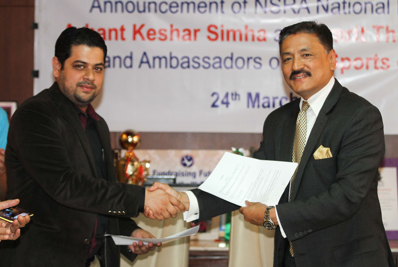 BS Sports Director M Ali Babar (left) exchanges the MoU with NSRA president Kishore Maharjan during the signing ceremony in Kathmandu on Thursday. Photo: THT