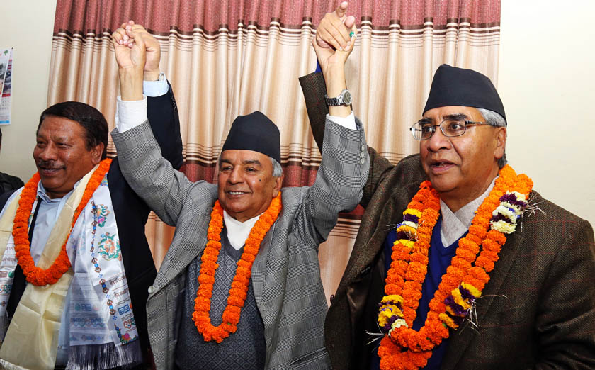 Outgoing General Secretary Prakash Man Singh, outgoing Acting President Congress Ram Chandra Paudel and newly elected President of Nepali Congress Sher Bahadur Deuba at the party's central office in Sanepa. Photo: RSS