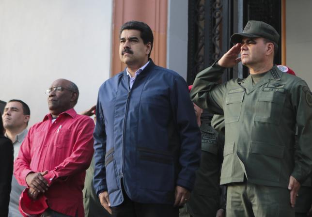 Venezuela's President Nicolas Maduro (C), Venezuela's Defence Minister Vladimir Padrino Lopez (R) and Venezuela's Vice President Aristobulo Isturiz, attend a ceremony at the National Pantheon in Caracas March 9, 2016. REUTERS/Miraflores Palace/Handout via Reuters