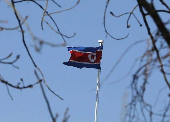 A North Korean flag is pictured at its embassy in Beijing January 6, 2016. North Korea said it had successfully conducted a test of a miniaturised hydrogen nuclear device on Wednesday morning. REUTERS/Kim Kyung-Hoon