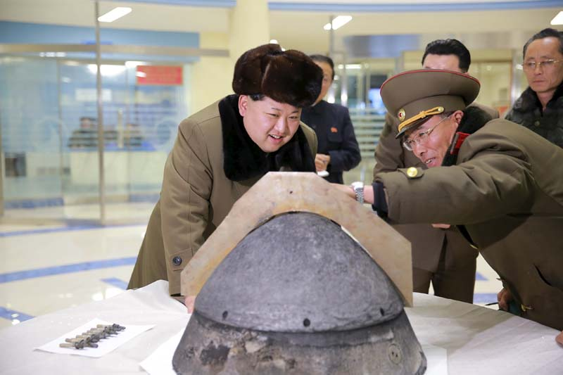 North Korean leader Kim Jong Un looks at a rocket warhead tip after a simulated test of atmospheric re-entry of a ballistic missile, at an unidentified location in this undated photo released by North Korea's Korean Central News Agency (KCNA) in Pyongyang on March 15, 2016. Photo: KCNA via Reuters/ File