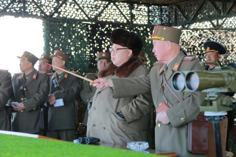 North Korean leader Kim Jong Un watches landing and anti-landing exercises being carried out by the Korean People's Army (KPA) at an unknown location, in this undated photo released by North Korea's Korean Central News Agency (KCNA) in Pyongyang on March 20, 2016. Photo: Reuters
