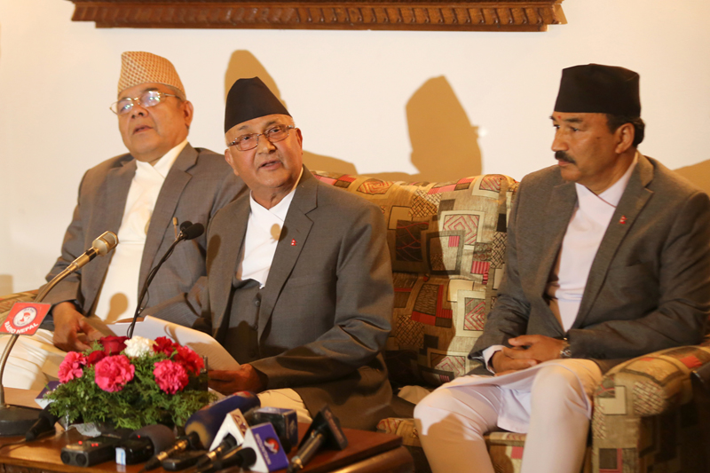 Prime Minister KP Sharma Oli (c) speaks with journalists upon his arrival at the Tribhuvan International Airport from an official China visit, in Kathmandu, on Sunday, March 27, 2016. Photo: RSS