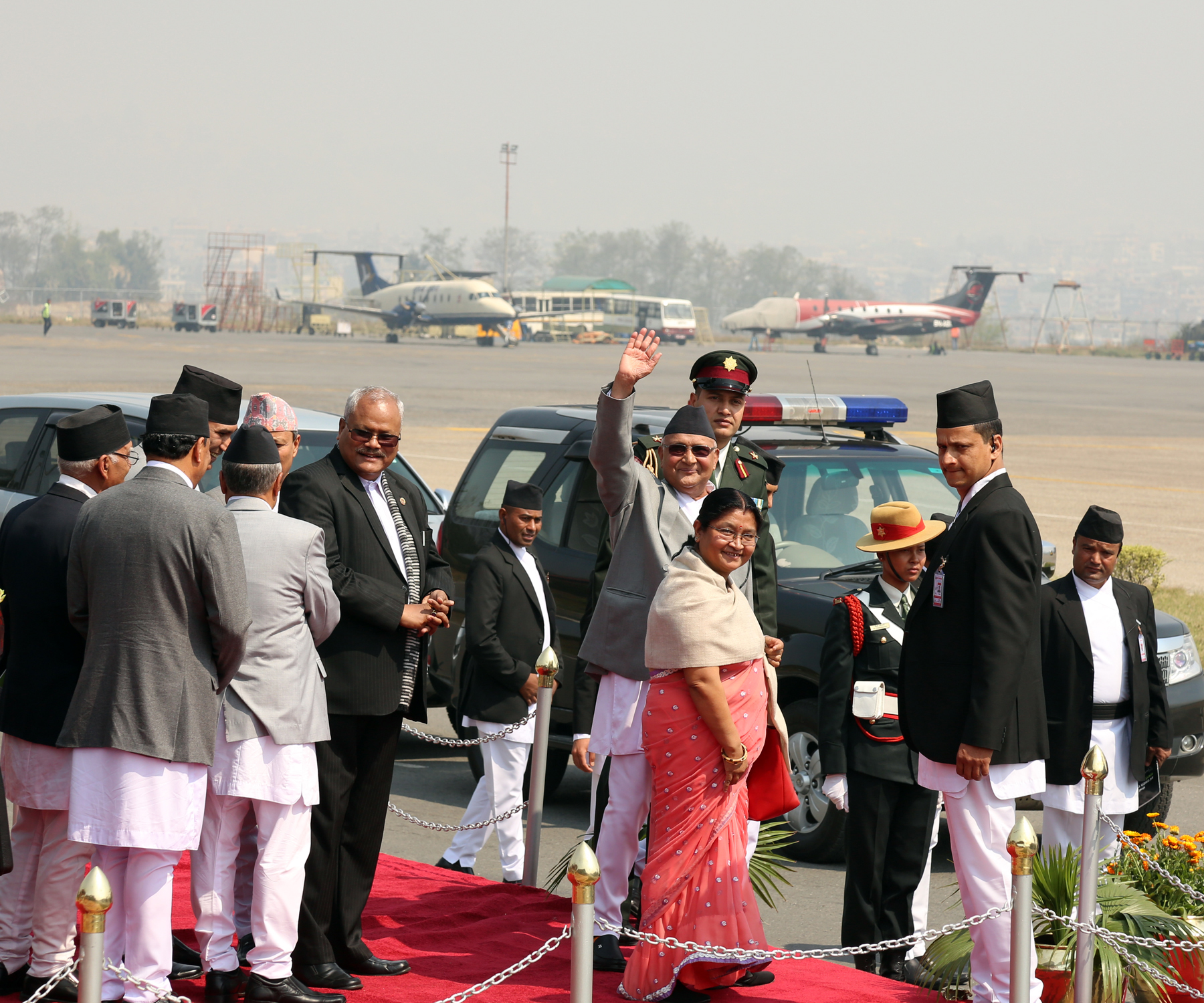 Prime Minister KP Sharma Oli waves  before he leaves for China on Sunday, March 20, 2016. Photo: RSS
