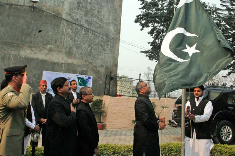 Pakistani Ambassador for Nepal Mazhar Javed hoists the Paksitani national flag during a special programme held on the eve of 76th National Day of Pakistan, at the Embassy of Pakistan, in Maharajgunj, on Wednesday, March 23, 2016. Courtesy: Embassy of Pakistan