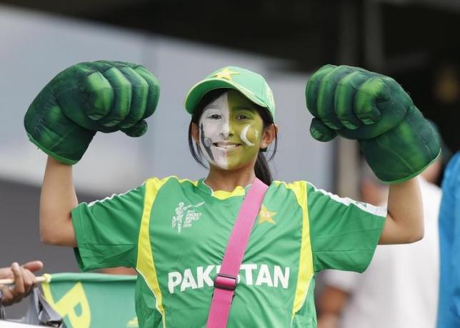 A young Pakistani fan shows her muscles before South Africa's Cricket World Cup match against Pakistan in Auckland, March 7, 2015. REUTERS/Nigel Marple/Files