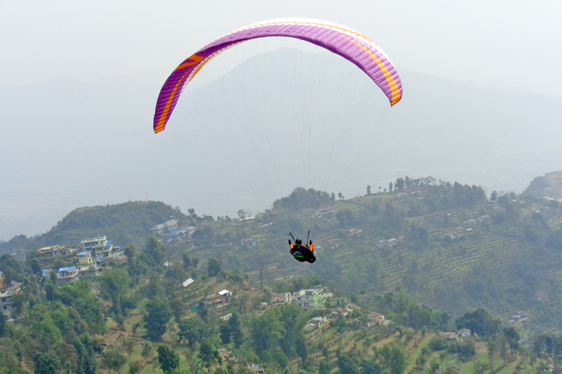 A tourist enjoying paragliding in Pokhara on Tuesday, March 15, 2016. Photo: RSS