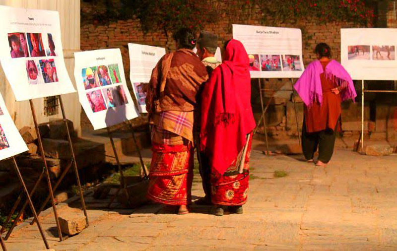 Locals of Bungmati take part in an open air photo/video exhibition at Machhindra Bahal in Lalitupur on Sunday, March 20, 2016. Photo: THT Online
