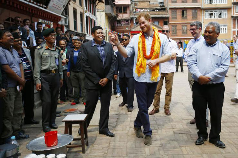Prince Harry gestures to a gathering of people in the premises of Golden Temple near the Patan Durbar Square in Lalitpur on Sunday, 20 March 2016. Photo: Skanda Gautam.