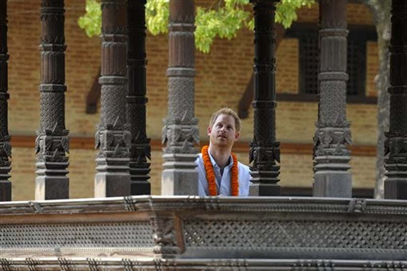 Britain's Prince Harry inspects the heritage sites at the Patan Durbar Square in Lalitpur, on Sunday, March 20, 2016. Photo: Prakash Mathema via AP