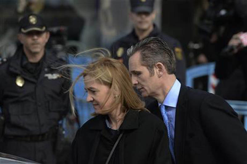 FILE - In this Feb. 9, 2016 file photo, Spain's Princess Cristina and her husband Inaki Urdangarin, leave a makeshift courtroom after attending a corruption trial, in Palma de Mallorca, Spain. Photo: AP