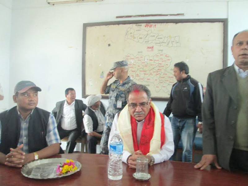 UCPN-Maoist Chairman Pushpa Kamal Dahal interacting with top government officials in Damauli of Tanahun district on Saturday, March 26, 2016. Photo: Madan Wagle