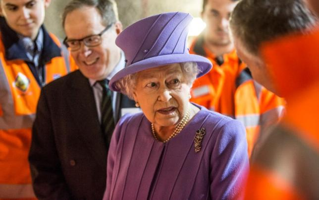 Britain's Queen Elizabeth attends the formal unveiling of the new logo for Crossrail, which is to be named the Elizabeth line, at the construction site of the Bond Street station in central London, February 23, 2016. REUTERS/Richard Pohle/Pool