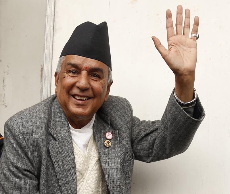 Nepali Congress President candidate Ram Chandra Paudel waves while casting vote in the election during the party's 13th national general convention in Kathmandu on Sunday, March 6, 2016. Photo: RSS