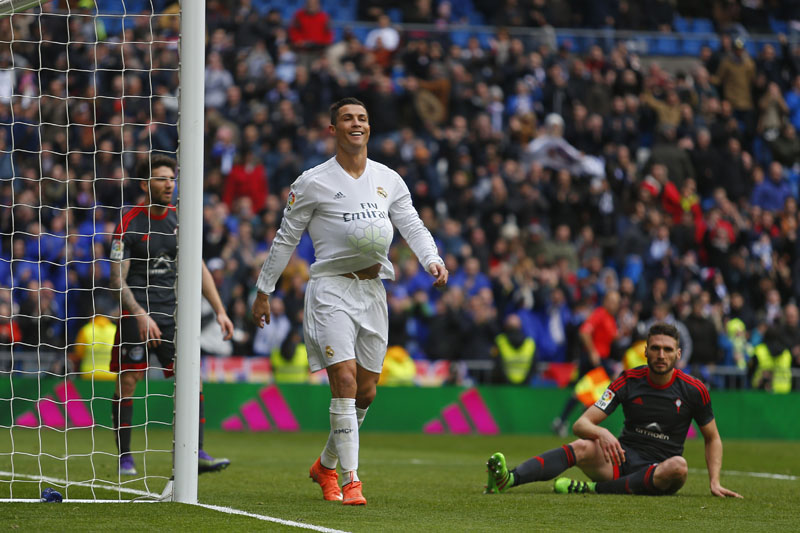 Real Madrid's Cristiano Ronaldo (centre) celebrates after scoring a goal against Celta during a Spanish La Liga soccer match between Real Madrid and Celta Vigo at the Santiago Bernabeu stadium in Madrid, on Saturday, March 5, 2016. Photo: AP