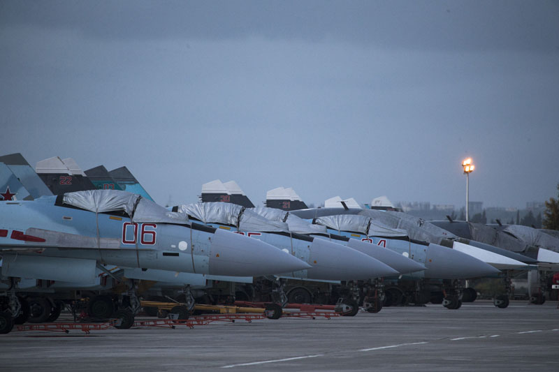 FILE - Russian fighter jets and bombers are parked at Hemeimeem air base in Syria, on Friday, March 4, 2016. Photo: AP