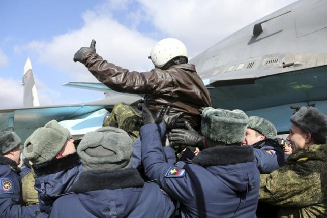 A Russian military pilot is greeted upon his return from Syria to a home airbase during a welcoming ceremony in Buturlinovka in Voronezh region, Russia March 15, 2016. REUTERS/Russian Ministry of Defence/Olga Balashova/Handout via Reuters
