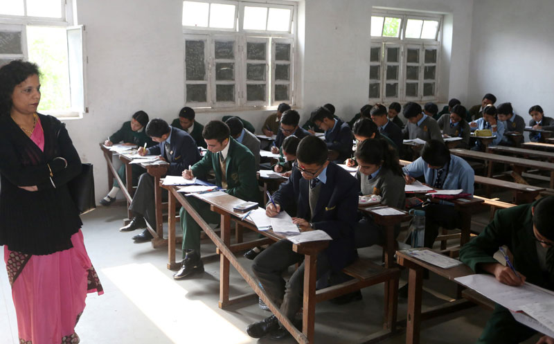Students attend the School Leaving Certificate (SLC) exams at the Dillibazaar-based Kanya Higher Secondary School in the Capital on Thursday, March 31, 2016. Photo: RSS