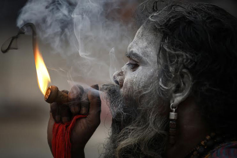 A sadhu smoking marijuana on the Pashupatinath Temple premises in the Capital on Sunday, March 06, 2016. Photo: Skanda Gautam