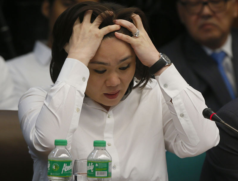 Salud Bautista, head of a remittance company Philrem, testifies before Philippine Senate Blue Ribbon Committee probe into how about $81 million of Bangladesh's stolen funds were transmitted online to four private accounts at a branch of the RCBC on Tuesday, March 15, 2016 in Manila, Philippines. Photo: AP