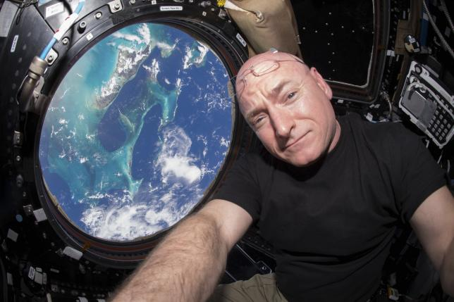 NASA astronaut Scott Kelly is seen inside the cupola of the International Space Station, a special module that provides a 360-degree viewing of the Earth and the station in this undated photo released on March 11, 2016. REUTERS/NASA/Handout via Reuters