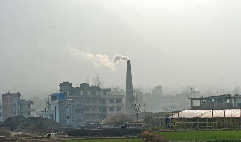 Smoke coming out of a brick kiln chimney, in Bhaktapur, on Friday. Photo: THT