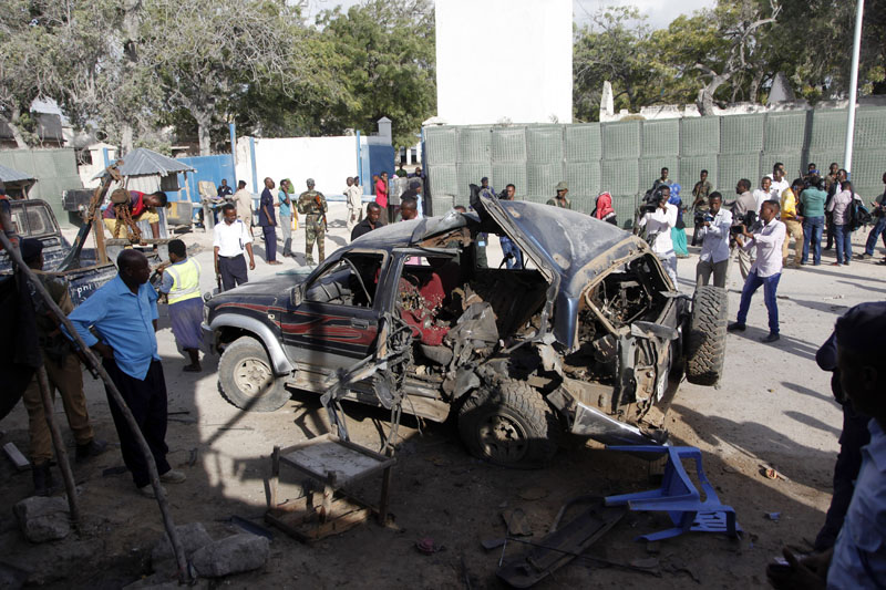 The wreckage of a car used for a suicide bombing sits outside a police academy in Mogadishu, Somalia, on Wednesday, March 9, 2016. Photo: AP
