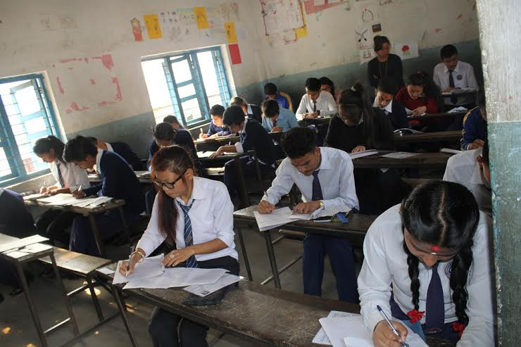Students writing their papers in the School Leaving Certificate Examinations (SLC) at the Jana Bikas Higher Secondary School in Chandidanda of Lamjung on Thursday, March 31, 2016. Photo: Ramji Rana