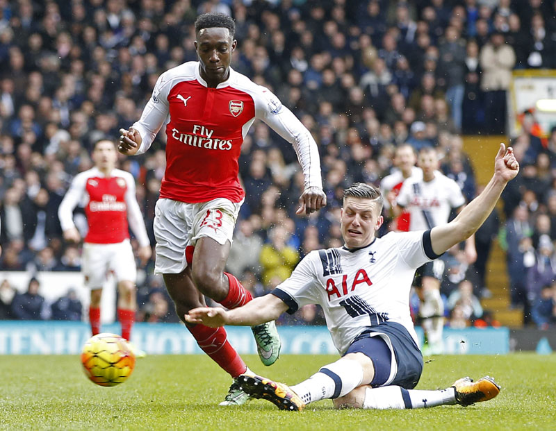 Arsenal's Danny Welbeck (left) in action with Tottenham's Kevin Wimmer at the White Hart Lane stadium in London, on Saturday, March, 5, 2016. Photo: Reuters