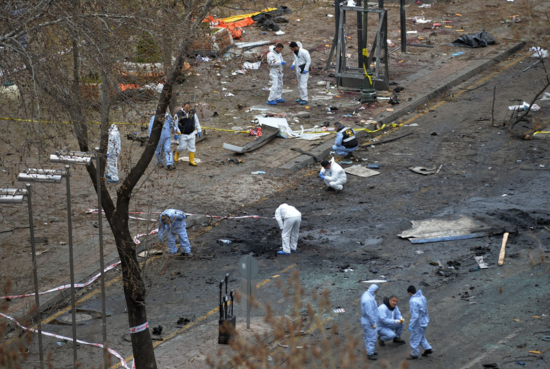 Police forensic officials work at the Sunday's explosion site in Ankara, Turkey, on Monday, March 14, 2016. Photo: AP