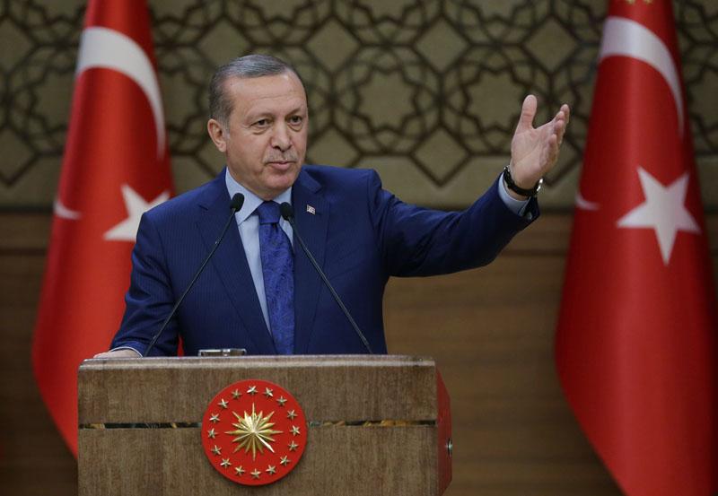 Turkish President Recep Tayyip Erdogan addresses a meeting of local administrators at his palace in Ankara, Turkey, on Wednesday, March 16, 2016. Photo: Murat Cetinmuhurdar, Presidential Press Service, Pool via AP