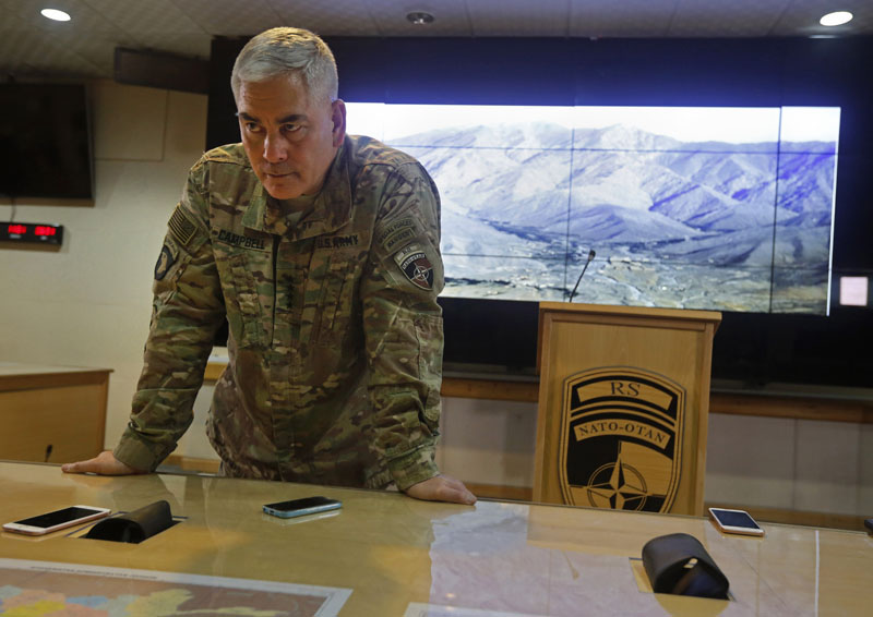 US Army General John F Campbell, commander of US and NATO forces in Afghanistan, listens to journalists during a news conference at Resolute Support headquarters, in Kabul, Afghanistan, Saturday, February 13, 2016. Photo: Omar Sobhani/Pool Photo via AP