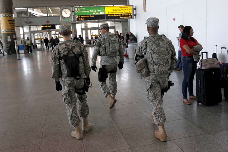 US Army security officers patrol inside New York's John F. Kennedy International Airport in New York on March 22, 2016. Photo: Reuters/ File