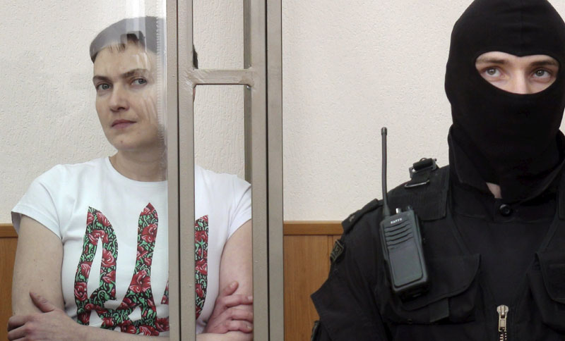 Former Ukrainian army pilot Nadezhda Savchenko looks out from a glass-walled cage during a verdict hearing at a court in the southern border town of Donetsk in Rostov region, Russia, on Monday, March 21, 2016. Photo: Reuters