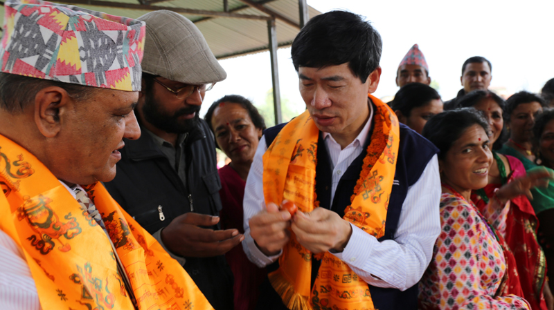 United Nations Assistant Secretary General Haoliang Xu takes stock of post-earthquake recovery efforts from the people in Thansing village in Nuwakot district, on Saturday, March 12, 2016. Photo: UNDP