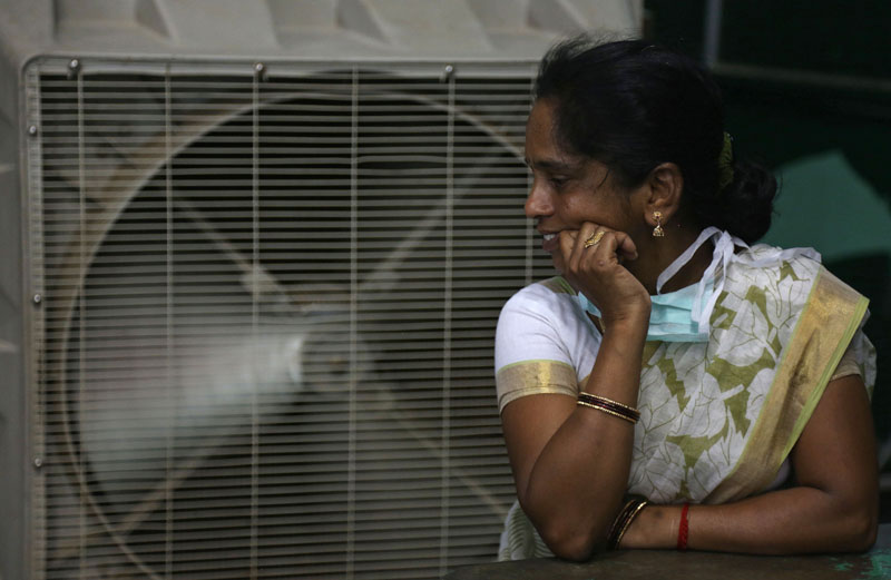 FILE - An Indian women stands in front of an air cooler to cool herself on a hot summer day in Hyderabad, in the southern Indian state of Telangana, on May 31, 2015. Photo: AP