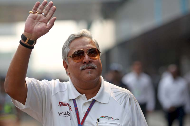 Force India team principal Vijay Mallya waves in the paddock during the third practice session of the Indian F1 Grand Prix at the Buddh International Circuit in Greater Noida, on the outskirts of New Delhi, India, on October 27, 2012. Photo.: Reuters/ File