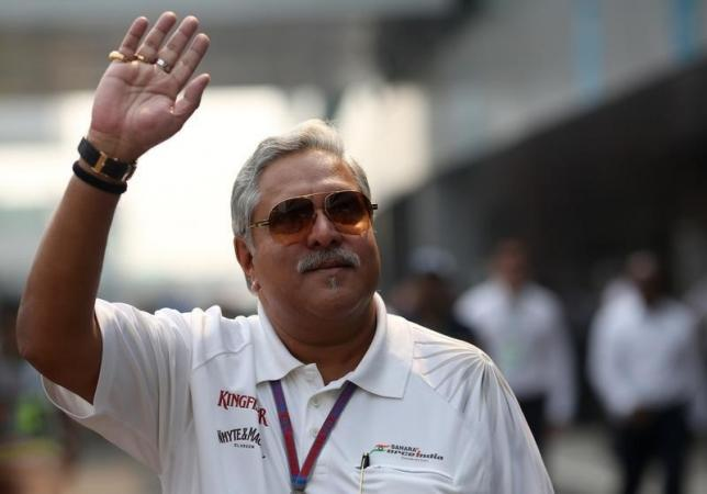 Vijay Mallya waves in the paddock during the third practice session of the Indian F1 Grand Prix at the Buddh International Circuit in Greater Noida, on the outskirts of New Delhi, October 27, 2012. REUTERS/Ahmad Masood/Files