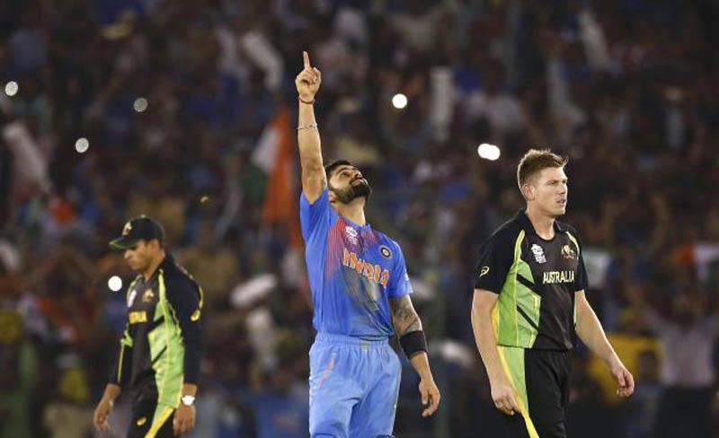 India's Virat Kohli (C) celebrates as Australia's James Faulkner (R) and Usman Khawaja walk after India won their match. Photo: Reuters