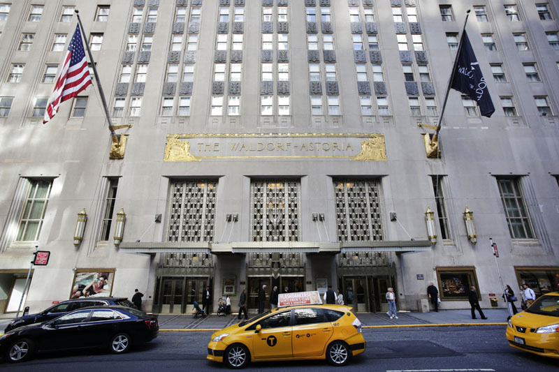 FILE - A taxi passes in front of the fabled Waldorf Astoria Hotel in New York, on October 6, 2014. Photo: AP
