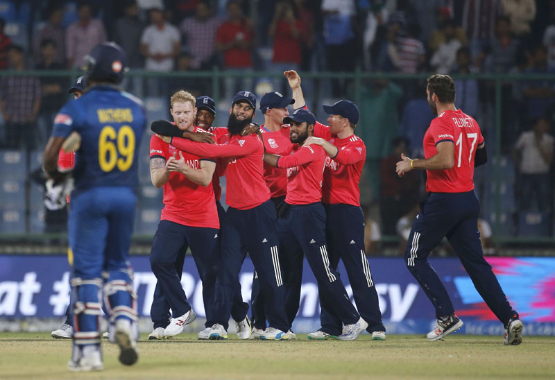 England's players celebrate after winning their match, World Twenty20 cricket tournament in New Delhi, India, on March 26, 2016. Photo: Reuters