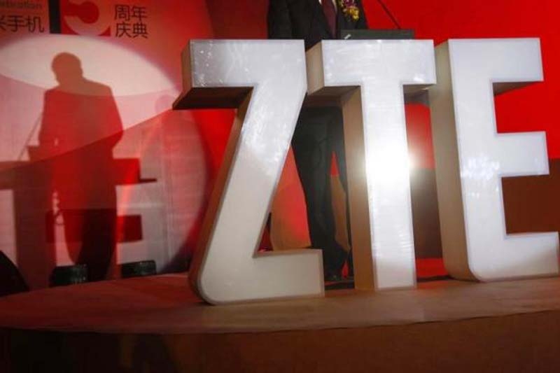 The ZTE Corp's logo is seen as a guest delivers a speech during the company's 15th anniversary celebration in Beijing on April 18, 2013. Photo: Reuters