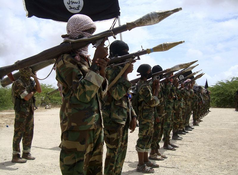File - Al Shabaab militants parade new recruits after arriving in Mogadishu from their training camp south of the capital in this October 21, 2010. Photo: Reuters